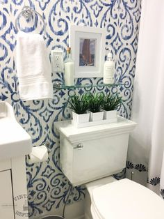 Make a Tiny Bathroom Feel Bright and Spacious Blue & White Bathroom Makeover: This bathroom makeover changes everything! It is almost bittersweet that I write this post today, as it wraps up the final bathroom renovation reveal for our lakehouse. Blue White Bathrooms, White Bathroom Decor, Tiny Bathrooms, Tiny House Bathroom, Bathroom Interior, Bathroom Ideas, Budget Bathroom, Bathroom Organization, Wall Paper Bathroom