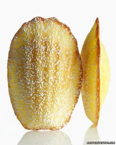 Lemon Madeleines by Martha Stewart. Like little cakes with a citrus perfume, these European darlings are equally delightful as a light dessert with fresh fruit or on their own at teatime. Lemon Desserts, Lemon Recipes, Köstliche Desserts, Delicious Desserts, Dessert Recipes, Yummy Food, Dessert Healthy, Plated Desserts, Yummy Yummy
