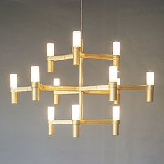 The Nemo Crown Minor Chandelier has major impact in contemporary interiors. A modern design inspired by classic candle chandeliers, Crown Minor features perfectly straight arms with 12 cylindrical shade holders and Opal White glass shades. While available in multiple finishes, the Gold finish is sold exclusively at Lumens.