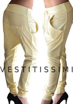 Pantaloni donna sportivi fitness colore giallo con zip obliqua, tasche e laccio in vita