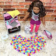 We made Gabriela a new heart Pom Pom rug! We made a few other shapes and colors also! This  is a great craft for rainy, snowy, or sick days! #dollcrafts #americangirl #americangirlideas #agi #goty2017 #agig #justcraftit #pompom #pompomrug