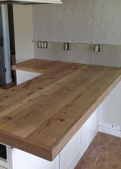 """Reclaimed Wood Countertop love that there's no wall behind all of the counter.DIY Reclaimed Wood Countertop - adding trim boards along edgeReclaim Reclaim, reclaiming or reclamation means """"to get something back"""". It may refer to: Outdoor Kitchen Countertops, Diy Countertops, Countertop Overlay, Painted Countertops, Countertop Redo, Kitchen Redo, Rustic Kitchen, Kitchen Ideas, Kitchen Cabinets"""