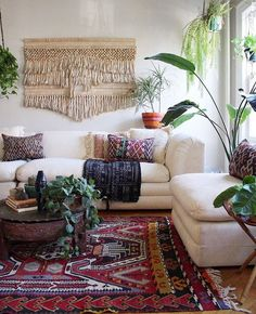 eclectic living room with plants and macrame