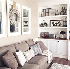 Replace family photos with mirrors and simplistic art and decor. Mirrors enlarge a room and decor allows the buyer to personalize their own space. Home Staging Tips and Ideas Improve the Value of Your Home on Frugal Coupon Living. - April 27 2019 at Living Room Mirrors, Cozy Living Rooms, New Living Room, My New Room, Wall Mirrors, Living Room Wall Decor Ideas Above Couch, Living Room Hutch, Living Room Themes, Mirror Art