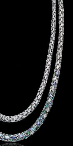 Diamonds and platinum—two of nature's hardest creations—evolve into curving necklaces that drape with a softness that belies their elements. A masterful feat of engineering and movement, they flow and float sensually over the body with an ease that subtly shifts shape and shade.