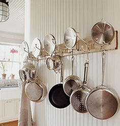 This kitchen pot rack started life as a coat hanger. Rather than throw it in a landfill, it got a second chance as a kitchen gizmo. Taken from the FB page When the Dinner Bell Rings Hanging Racks, Hanging Pots, Hanging Storage, Smart Kitchen, Kitchen Small, Kitchen White, Kitchen Storage Solutions, Kitchen Organization, Organizing Solutions