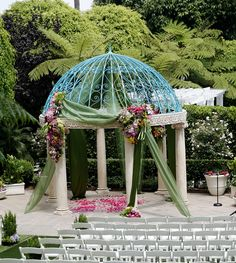 #Gazebo draped and adorned with assorted flowers