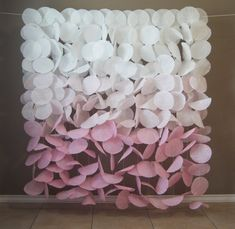 This gorgeous soft pink ombre paper garland backdrop would be a stunning accent for birthdays, weddings, or any other special occasion. This airy garland captures light beautifully to create a whimsical backdrop for any event. The displays features a beautiful vertical ombre fading from white to pale and medium baby pink. Each coffee filter is hand-dyed to create the bold and earthy colors. This display is made of 15 strands of 8 ft long garland. The strands have been looped over the…