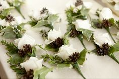 buttonhole - 3rd choice - like the idea of incorporating pine cones.  do not want white, white flowers (but rather ivory)