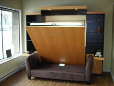 Wow!  Murphy bed opens over a couch...arms of the couch become sides to the bed.