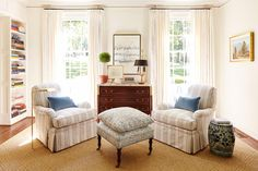 Pretty Little Corner - Best Houses of 2016 - Southernliving. Right in front of the living room window, Sarah Bartholomew created a pretty little mise-en-scéne with blue and white stripe upholstered club chairs and a pert, pillow-topped ottoman. The art behind is by her friend, Kaycee Hughes.