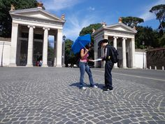 Rome: looking for piazza del popolo on the map. She said that way and I said the other way :)