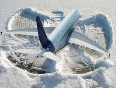 Grounded Plane Makes Snow Angel On Tarmac