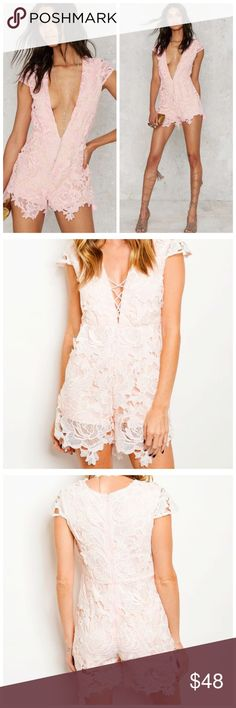 """Pink Lace Romper Available in sizes small, medium & large. Was sold at Nasty Gal! Boutique brand. Would be beautiful for Valentine's Day!  • Lattice V-neck Front • Delicate Lace • Cap Sleeves • Cotton/Polyester  Model is wearing a size small.   L: 31"""" B: 36"""" W: 28""""  *Model shown wearing the exact product.  If you have any questions, feel free to ask! 💕 Nasty Gal Pants Jumpsuits & Rompers"""