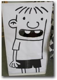 "Diary of a Wimpy Kid - Rowley bean bag toss...cut out the mouth and have kids throw ""cheese slice"" bean bags in the mouth"