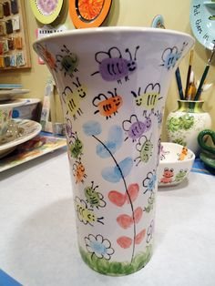 A local elementary school contacted us about having the students create some pottery pieces to auction off in an upcoming school fundraiser. The school created six pottery pieces — one for e… School Auction Projects, Class Art Projects, Collaborative Art Projects, Auction Ideas, Classroom Projects, Art Classroom, Fingerprint Art, Footprint Crafts, Handprint Art