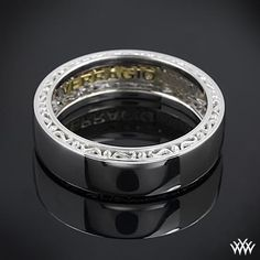 Men with Flair! 14k White Gold Verragio High Polish Wedding Ring. This Men's Verragio Wedding Ring features a compelling design that will highlight your guys individuality without overpowering it.