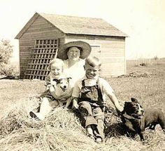 """Family Treasure - North Dakota From internet friend Kitra Nelson. She told us, """"Here is a photo of my grandpa (Jerome Johnson)and his dog. He was born in 1930, so this photo was taken in the 1930's in rural North Dakota. He is holding onto his very best friend! The other little dog is pretty cute, too"""