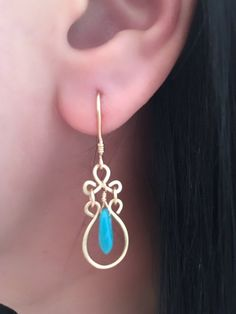 These earrings are entirely hand wired and shaped. All wires have been hammered for a finished textured look. Ear wires are hand shaped and made with 14K Gold Filled wire.