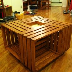 Coffee table I'm making. Built the crates, stained and sealed it. Just need to finish the inset center piece. #furniture #woodwork #DIY