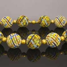 detail of beaded bead necklace by Elaine Felhandler
