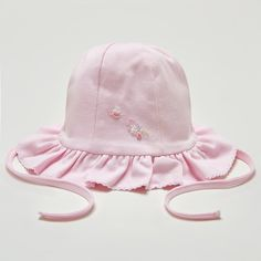 An adorable floppy hat for baby girls by Kissy Kissy. Made with 100% soft Peruvian pima cotton for softness and comfort. Lovely embroidered and beaded floral motif. Ruffled edges. The hat secures with a tie under the chin. Perfect for protecting baby's delicate head on sunny days. A wonderful hat for those special occasions. Complete …