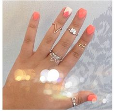 Coral and white nails with triangle geometric design; Instagram nails
