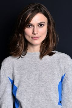 Sometimes, all you need to update your hair is to cut some long side bangs into it, like Keira Knightley's easy style.