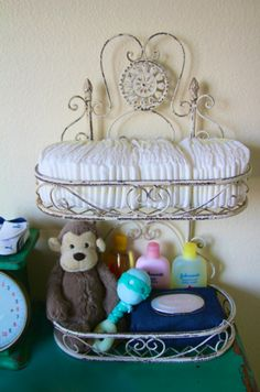 Unique diaper storage on change table. Our diapers are pretty patterns, this would look really cool