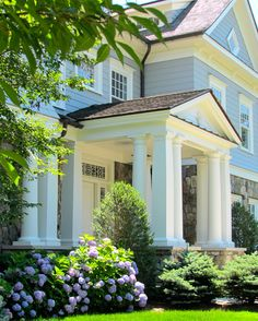 Multiple sets of columns on the porch creates a fabulous look  (Gardiner and Larson Homes, CT)