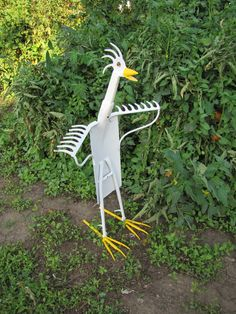 Funky Chicken- One of a Kind Metal Art Sculpture made with Antique, Vintage and Salvaged Metal- Yard Bird- Garden Sculpture. $135.00, via Etsy.
