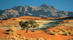 The craggy mountains of the Naukluft against the red dunes of the Namib - surreal colours, no matter what time of day