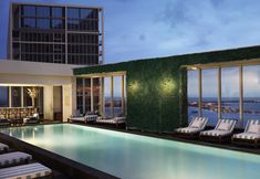 Viceroy Miami Hotel & Resort  I really like this green wall for exterior pools. Very Chic!