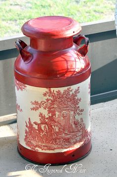 Milk can with style.  This would be an easy DIY project with a little paint and the right fabric.....and of course you need the old banged up milk can!