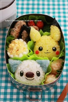 Charaben/Kyaraben bento featuring Pikachu and Oshawott onigiri. Squee! They're too cute to eat!