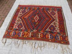 Check out this item in my Etsy shop https://www.etsy.com/listing/506888152/square-colorful-kilim-rugdecorative
