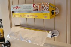 Use Command hooks for foil/wax paper/saran wrap - genius!