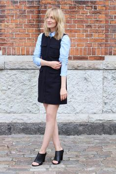 Danish Bloggers to Follow For Copenhagen Fashion Week - Denmark girl Marie Hindkaer Wolthers (of fashion blog 'Blame it on Fashion') might live in London now, but she's every bit a  Scandinavian minimalist. Here she styled a classic blue button-down shirt under an LBD with trendy utility pockets, and finished the look with black mules