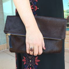 Any closet would be instantly happier with this merlot, calf hair Clare V. foldover clutch. Need! #clarev #clarevivier #calfhair #musthave #want #need #fall #fall16 #fall2016 #fashion #accessorize #luxe #style #stylish #love #staple #classic #musthave #leather #luxury #willow #willowboulder