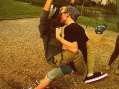 Cute gay couple on a swing together. <3