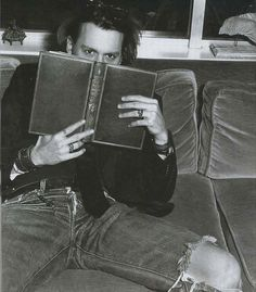 Johnny Depp of course loves books! One can tell. :)