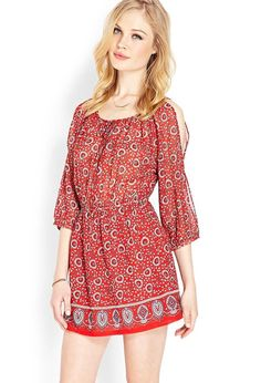 A sheer peasant-style dress featuring a botanical print. Split round neckline with self-tie closu...