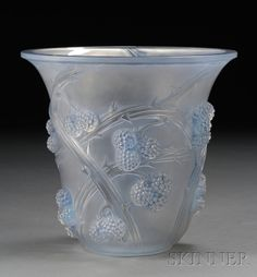 René Lalique Mûres Vase. Art glass. Marcilhac no. 1058, France, 1932-1947. Etched blue-tinged glass with berries and thorned bramble in relief, marked R. Lalique in block letters on base.