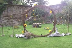 """""""Who looks outside dreams, who looks inside awakens"""" Carl Jung A large contemporary design using sunflowers which turn to follow the path of the sun. The flowers face out and in to depict the above quotation"""