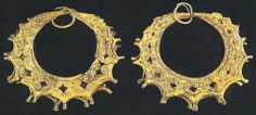 Gold earrings from Shaft Grave III of Grave Circle A at Mycenae. (Athens, National Archaeological Museum, 61). Second half of 16th century BC.