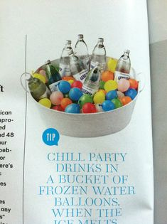 Chill party drinks in a bucket of frozen water balloons. {Martha Stewart- Living}