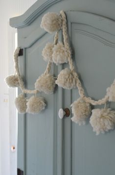 pompom garland   I like the simplicity of the matching string