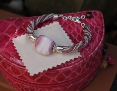 WE LOVE CANDIES! - Pink and white colored bangle. The harringbone spiral is adorned with a central ceramic bead which reminds me of a candy. Dedicated to my dear friend Lucia in memory of our chats in Iasi, accompanied by a slice of cake.
