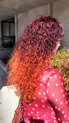 Red Curly hair ombré. Formulated by Kaeli Daehler at Emerald City Hair Studio. Top 10 Best Hair Color Salons in Sacramento #EmeraldCityHair #AvedaColor #Aveda #RedHair #cherryredhair http://www.EmeraldCityHair.com