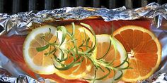 Laks med sitron- og appelsinskiver / Salmon with lemon, orange and a twig of rosemary to give it that little bit extra...